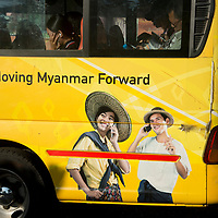 Myanmar (Burma). Yangon. Public bus painted with an advert saying 'Forward Myanmar'.
