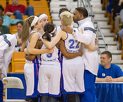 Fairmont Senior players huddle up before the tip against Bridgeport during a first round game at the Charleston Civic Center.