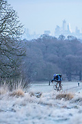 UNITED KINGDOM, London: 30 January 2019 A cyclist braves the cold this morning as he makes his way through a frosty Richmond Park with the London skyline in the background. The cold weather has caused chaos across the country and is set to get colder in the next few days.<br /> Rick Findler / Story Picture Agency