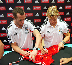 KUALA LUMPUR, MALAYSIA - Friday, July 15, 2011: Liverpool's new signing Charlie Adam and Dirk Kuyt sign autographs during a promotional event at the Adidas store at the Mid Valley Shopping Centre on day five of the club's Asia Tour. (Photo by David Rawcliffe/Propaganda)