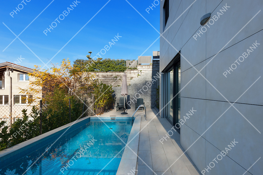 external of a modern house, swimming pool