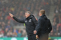 Football - 2019 / 2020 Premier League - AFC Bournemouth vs. Manchester United<br /> <br /> Manchester United Manager Ole Gunnar Solskjaer gives some instructions from the sidelines as Bournemouth's Manager Eddie Howe looks on during the Premier League match at the Vitality Stadium (Dean Court) Bournemouth  <br /> <br /> COLORSPORT/SHAUN BOGGUST
