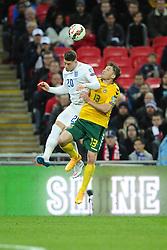Ross Barkley of England (Everton) battles for the high ball with Saulius Mikoliunas of Lithuania  - Photo mandatory by-line: Joe Meredith/JMP - Mobile: 07966 386802 - 27/03/2015 - SPORT - Football - London - Wembley Stadium - England v Lithuania - UEFA EURO 2016 Qualifier
