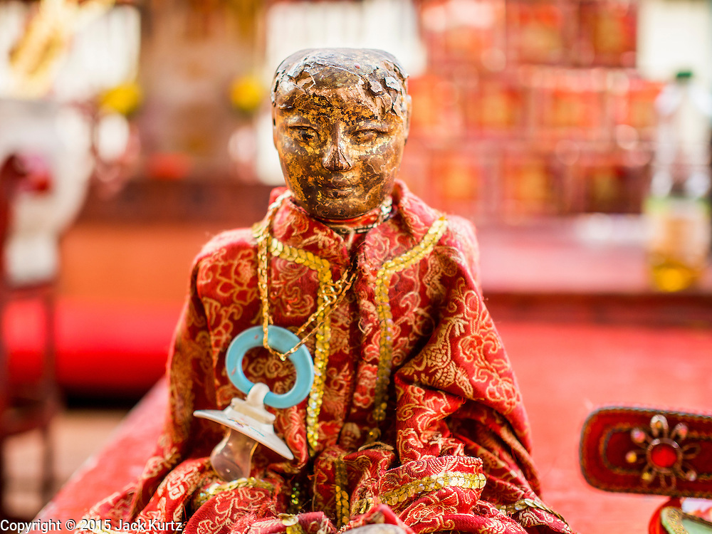 16 JANUARY 2015 - BANGKOK, THAILAND: A baby doll at the Chaomae Thapthim Shrine, a Chinese shrine in a working class neighborhood of Bangkok near the Chulalongkorn University campus. The doll is a part of the Sai Yong Hong Opera Troupe's performance at the shrine. The troupe's nine night performance at the shrine is an annual tradition and is the start of the Lunar New Year celebrations in the neighborhood. Lunar New Year, also called Chinese New Year, is officially February 19 this year. Teochew opera is a form of Chinese opera that is popular in Thailand and Malaysia.    PHOTO BY JACK KURTZ