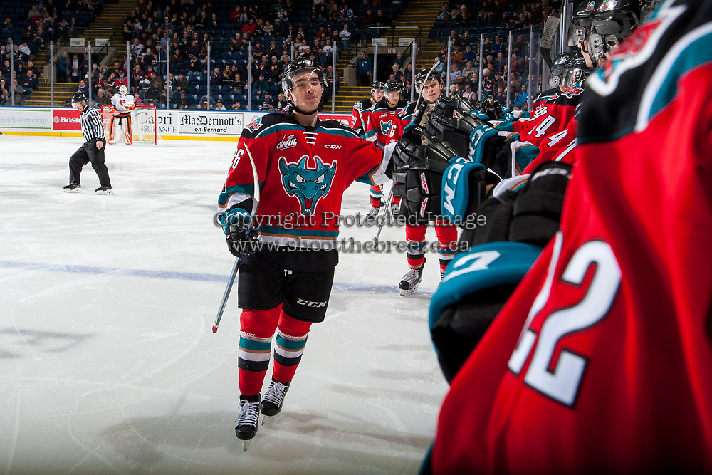 KELOWNA, CANADA - NOVEMBER 25: Liam Kindree #26 of the Kelowna Rockets fist bumps the bench after scoring a second period goal against the Medicine Hat Tigers on November 25, 2017 at Prospera Place in Kelowna, British Columbia, Canada.  (Photo by Marissa Baecker/Shoot the Breeze)  *** Local Caption ***