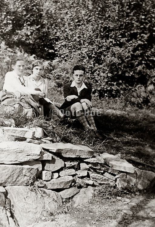 young adult people resting while on a day hiking trip England 1930s