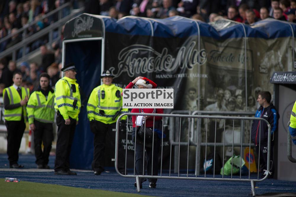 A woman with the festive spirit hangs onto her santa hat in the Falkirk v Rangers Falkirk Stadium 19 December 2015<br /><br />(c) Russell G Sneddon / SportPix.org.uk