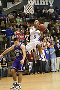 Jerel Carter flies in for a layup over Strasburg's Martin Wiseley during their game with the Rams on January 26.  Madison has yet to play a game in February with multiple games either reschedule or cancelled due to recent snowfall.  The Varsity Boys Basketball team beat Strasburg tonight 87-55. David Falk led the way with 20 points and Matt Garr added 15. Madison (17-0;4-0)  Date:  January/26/10, MCHS Varsity Boys Basketball vs Strasburg Rams,