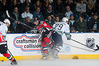 KELOWNA, CANADA - MARCH 18: Roberts Lipsbergs #29 of Seattle Thunderbirds checks Joe Gatenby #28 of Kelowna Rockets on March 18, 2015 at Prospera Place in Kelowna, British Columbia, Canada.  (Photo by Marissa Baecker/Shoot the Breeze)  *** Local Caption *** Joe Gatenby; Roberts Lipsbergs;