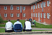 Prisoners socialising in the grounds of the prison during a recreation period. HMP The Mount, Bovingdon, Hertfordshire