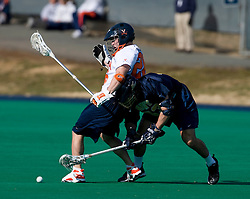 Virginia midfielder Brian Mcdermott (26) and Navy midfielder Frankie Coppola (53) battle for a loose ball.  The Virginia Cavaliers scrimmaged the Navy Midshipmen in lacrosse at the University Hall Turf Field  in Charlottesville, VA on February 2, 2008.
