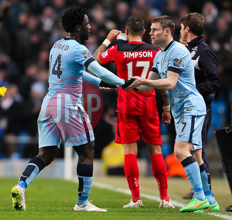 Manchester City's Wilfried Bony is replaced by Manchester City's James Milner  - Photo mandatory by-line: Matt McNulty/JMP - Mobile: 07966 386802 - 04/03/2015 - SPORT - football - Manchester - Etihad Stadium - Manchester City v Leicester City - Barclays Premier League