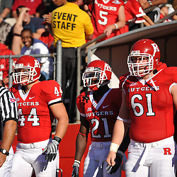 Sep 19, 2009; Piscataway, NJ, USA; Rutgers captains linebacker Ryan D'Imperio (44), cornerback Devin Mccourty (21) and center Ryan Blaszczyk (61) take the field for the first half of NCAA college football between Rutgers and Florida International at Rutgers Stadium.