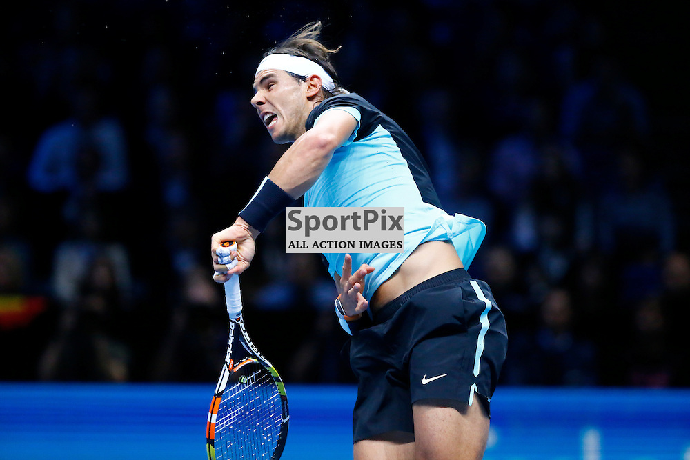 Rafael Nadal serves the ball. ATP Finals 2015 at O2 Arena, London. Stanislas Wawrinka plays Rafael Nadal in their first match in the Group Ilie Nastase. 16th November 2015. (c) Matt Bristow | SportPix.org.uk