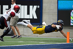 BERKELEY, CA - SEPTEMBER 12:  Tight end Raymond Hudson #11 of the California Golden Bears dives for the end zone after being pushed out of bounds by defensive back Malik Smith #12 of the San Diego State Aztecs during the second quarter at California Memorial Stadium on September 12, 2015 in Berkeley, California. The California Golden Bears defeated the San Diego State Aztecs 35-7. (Photo by Jason O. Watson/Getty Images) *** Local Caption *** Raymond Hudson; Malik Smith