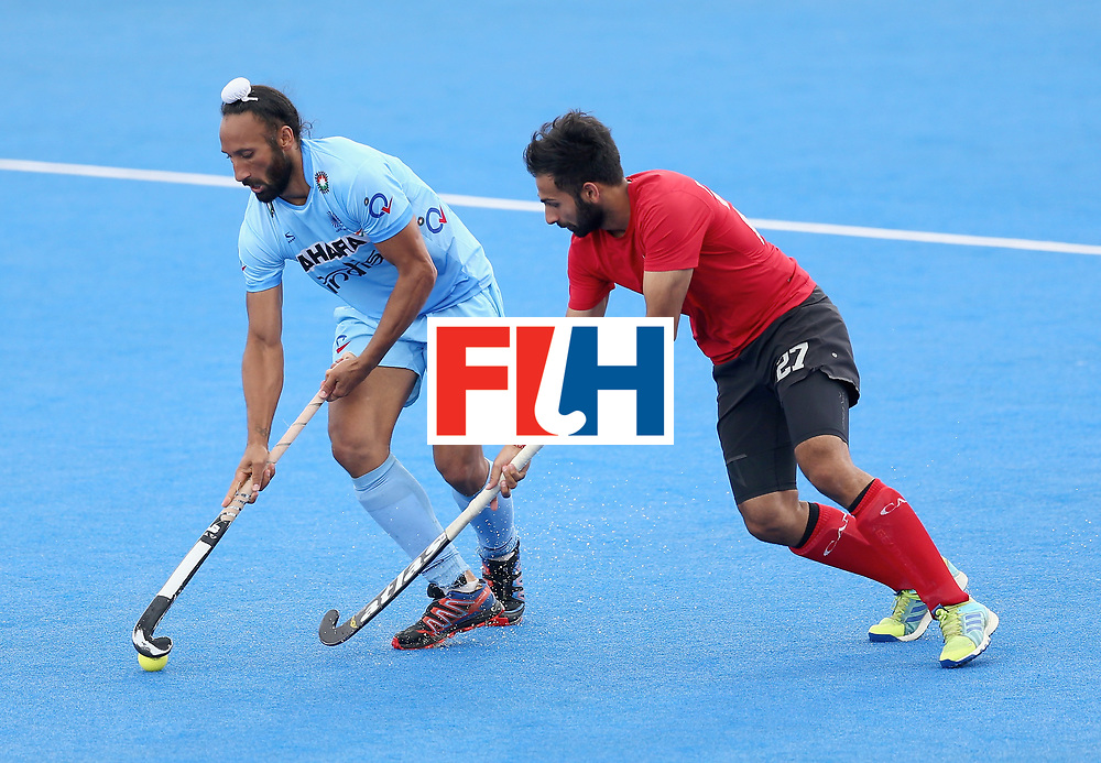 LONDON, ENGLAND - JUNE 25: Sardar Singh of India and Sukhi Panesar of Canada battle for possession during the 5th/6th place match between India and Canada on day nine of the Hero Hockey World League Semi-Final at Lee Valley Hockey and Tennis Centre on June 25, 2017 in London, England. (Photo by Steve Bardens/Getty Images)