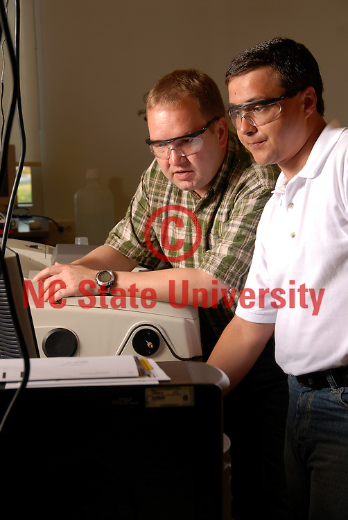 Jan Genzer works with an engineering colleague Dr. Kirill Efimenko.
