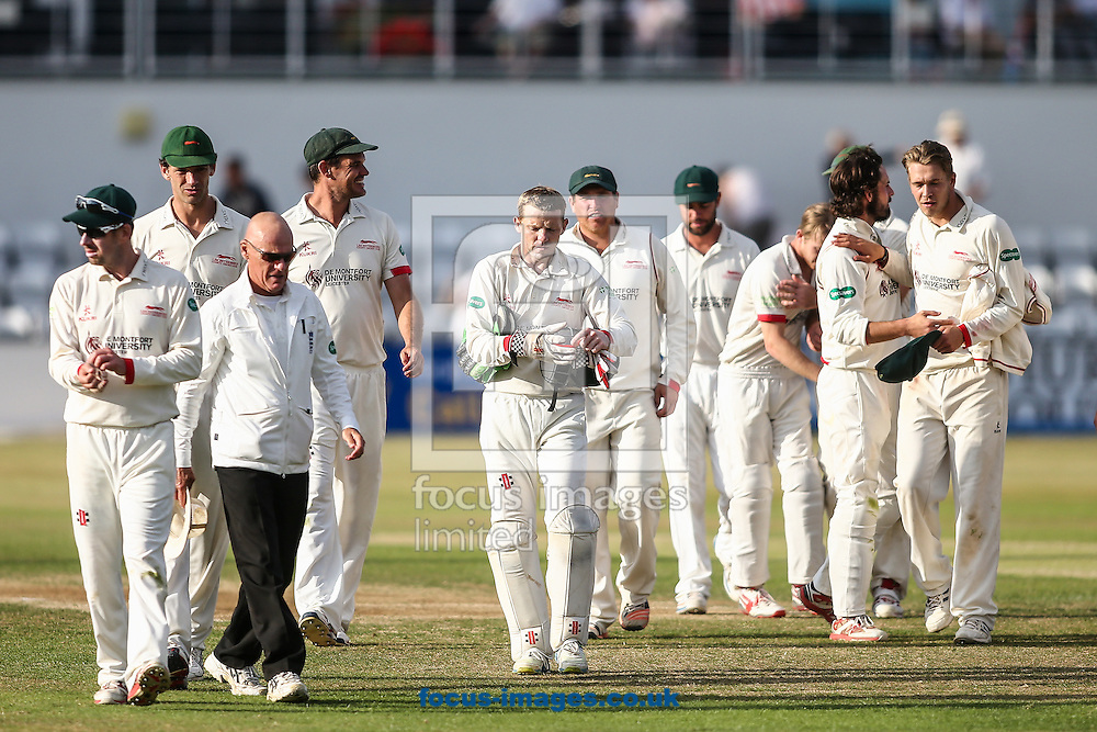 Leicestershire players leave the field at the end of day two during the Specsavers County C'ship Div Two match at the County Ground, Northampton<br /> Picture by Andy Kearns/Focus Images Ltd 0781 864 4264<br /> 14/08/2016