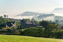 © Licensed to London News Pictures. 09/05/2020. Llanddewi'r Cwm, Powys, Wales, UK. St David's church in the small village of Llanddew'ir Cwm in Powys, UK is surrounded by early morning mist. Photo credit: Graham M. Lawrence/LNP