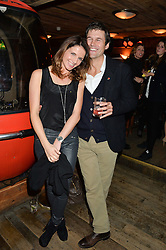 GENEVIEVE STEPHENS and ANDREW SWAINE at a party in honour of the Walking With The Wounded team members held at Bodo's Schloss, 2A Kensington High Street, London on 13th November 2013.