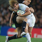 Aurelien Rougerie, France, is tackled by Sonny Bill Williams, New Zealand, during the New Zealand V France Final at the IRB Rugby World Cup tournament, Eden Park, Auckland, New Zealand. 23rd October 2011. Photo Tim Clayton...