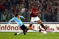 Roma 9/11/2003 <br />Roma Lazio 2-0 <br />John Carew (Roma) contrastato da Paolo Negro (Lazio)<br />John Carew (Roma) challenged by Paolo Negro (Lazio)<br />Foto Andrea Staccioli Graffiti