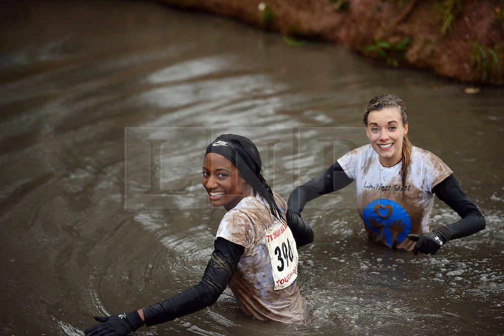 **EXCLUSIVE** ©  London News Pictures. 02/11/2013. Jayel Williams (left) and Dani Emery (right), Girlfriend of Manchester united player Ben Amos tackling part of the course. Wives and girlfriends of Premiership football players do part of the famous Tough Guy event in Wolverhampton, UK. Mandatory photo credit : Mike King/LNP