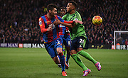 Joel Ward and Ryan Bertrand battle for posession during the Barclays Premier League match between Crystal Palace and Southampton at Selhurst Park, London, England on 12 December 2015. Photo by Michael Hulf.