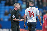 Mark Heywood (Referee) warns Gary Madine (Bolton Wanderers) about his foul during the EFL Sky Bet League 1 match between Bolton Wanderers and Swindon Town at the Macron Stadium, Bolton, England on 14 January 2017. Photo by Mark P Doherty.