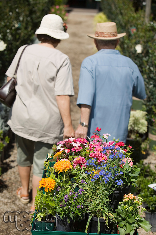 Senior Couple Shopping for Plants