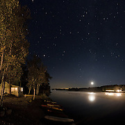 Oxtongue Lake on a late September evening with the moon and Milky Way visible, as seen from the Algonquin Inn.  This is 5-image  stitch.