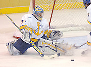 LSSU goaltender Brian Mahoney-Wilson stretches to make one of his 32 saves during the Lakers win over the OSU Buckeyes Friday night at Taffy Abel Arena in Sault Ste. Marie.