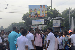 July 21, 2017 - Kolkata, West Bengal, India - Trinamool Congress activist shows poster against opposition during Martyrs Day rally in Kolkata. Trinamool Congress supporter from all around the West Bengal gathers in front of Victoria House to observe their Martyrs Day on July 21, 2017 in Kolkata. The 21 July Martyrs Day rally is annual mass rally organized by All India Trinamool Congress to commemorate the 1993 Kolkata firing where 13 people shot by police during the rally organized by Youth Congress under leadership of Mamata banerjee in demand of Voter Identity Cards. (Credit Image: © Saikat Paul/Pacific Press via ZUMA Wire)