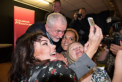 © Licensed to London News Pictures.  11/08/2017; Bristol, UK. JEREMY CORBYN, Leader of the Labour Party, arrives and speaks to Labour Party members at the BAWA Club in Filton, Bristol. Pro Corbyn supporters pose for selfies with Jeremy Corbyn. Picture credit : Simon Chapman/LNP