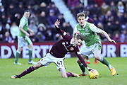 Harry Cochrane and 8 Vykintas Slivka clash during the William Hill Scottish Cup 4th round match between Heart of Midlothian and Hibernian at Tynecastle Stadium, Gorgie, Scotland on 21 January 2018. Photo by Kevin Murray.