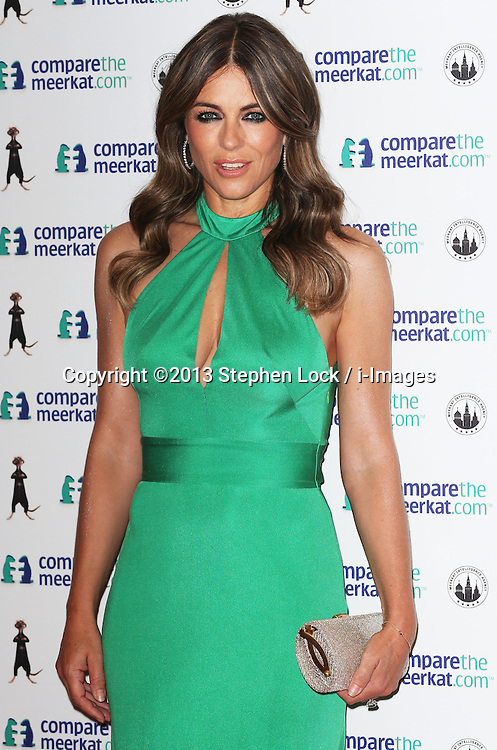 Elizabeth Hurley arriving at the launch of the Compare the Market.com special edition Agent Maiya toy in  London, Wednesday, 21st August 2013. Picture by Stephen Lock / i-Images