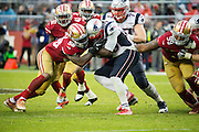San Francisco 49ers outside linebacker Eli Harold (58) tackles New England Patriots running back LeGarrette Blount (29) at Levi's Stadium in Santa Clara, Calif., on November 20, 2016. (Stan Olszewski/Special to S.F. Examiner)