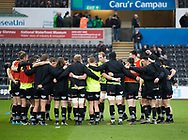 Ospreys team huddle during the pre match warm up<br /> <br /> Photographer Simon King/Replay Images<br /> <br /> Guinness PRO14 Round 19 - Ospreys v Connacht - Friday 6th April 2018 - Liberty Stadium - Swansea<br /> <br /> World Copyright &copy; Replay Images . All rights reserved. info@replayimages.co.uk - http://replayimages.co.uk