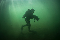 """Director and cinematographer Abraham Joffe (untitled films), underwater while filming the green anaconda (Eunectes murinus) in Bonito, Mato Grosso Sul, Brazil. Photographed while filming Tales by Light, Season 2, Episode 3, """"Misunderstood Predators"""", for Netflix and National Geographic Australia. August, 2016."""