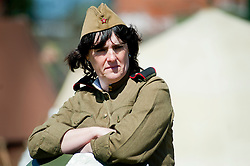 "A female Re-enactor portrays a  Soviet soldier from the Russian 13th Guards Rifle Division ""Poltavaskaya"" during a world war Two living History event at Fort Paull Nr Hull May 2011 Image © Paul David Drabble"