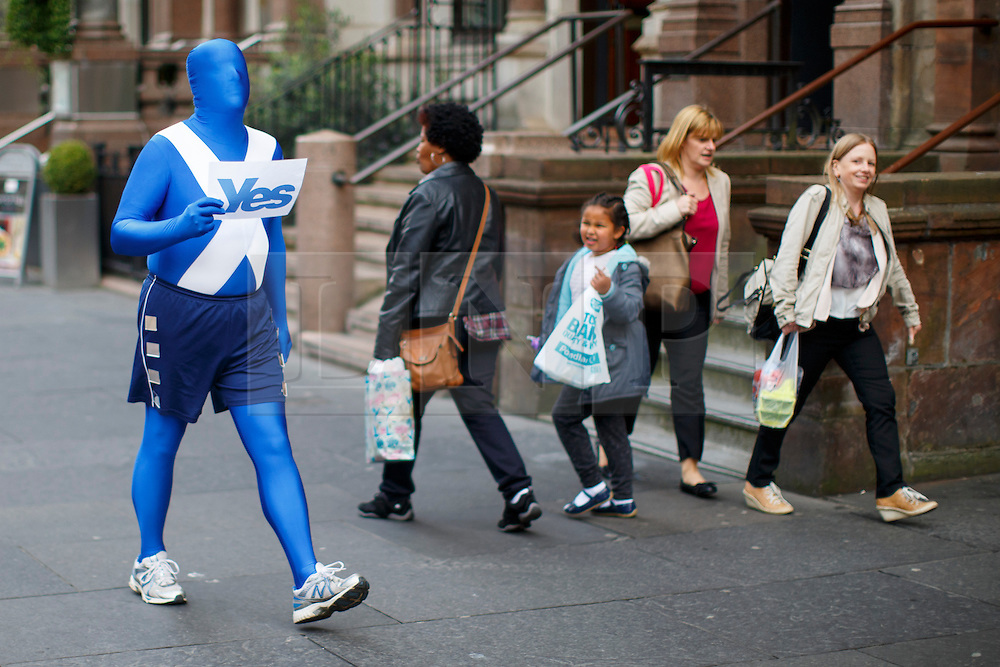 © Licensed to London News Pictures. 18/09/2014. Glasgow, UK. A 'Yes' campaigner walking in Glasgow city centre whilst people of Scotland going to polling stations to vote on the Scottish independence referendum on Thursday, 18 September 2014. Photo credit : Tolga Akmen/LNP