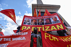 © Licensed to London News Pictures. 01/05/2018. LONDON, UK.  Demonstrators stand around Nelson's Column during the annual May Day Rally on International Workers' Day.  People marched through central London to a rally in Trafalgar Square.  Photo credit: Stephen Chung/LNP