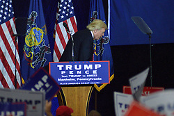 Republican presidential candidate DONALD TRUMP mimics his Democratic opponents during a rally in Mannheim, Lancaster County, PA , on October 1, 2016.