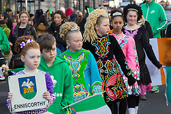 London, March 13th 2016. The annual St Patrick's Day Parade takes place in the Capital with various groups from the Irish community as well as contingents from other ethnicities taking part in a procession from Green Park to Trafalgar Square.  PICTURED: Little girls dressed in traditional Irish clothes dance along the route of the procession. ©Paul Davey<br /> FOR LICENCING CONTACT: Paul Davey +44 (0) 7966 016 296 paul@pauldaveycreative.co.uk