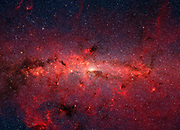 infrared image from NASA's Spitzer Space Telescope shows hundreds of thousands of stars crowded into the swirling core of our spiral Milky Way galaxy. In visible-light pictures, this region cannot be seen at all because dust lying between Earth and the galactic center blocks our view.