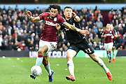 Aston Villa defender (on loan from AFC Bournemouth) Tyrone Mings (40) battles for passion with Middlesbrough striker (on loan from West Ham United) Jordan Hugill (11) during the EFL Sky Bet Championship match between Aston Villa and Middlesbrough at Villa Park, Birmingham, England on 16 March 2019.