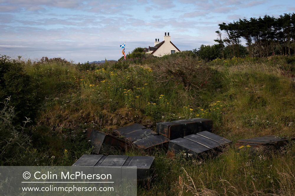'Metal boxes, 2018' from Colin McPherson's project 'Treasured Island' part of the Document Scotland exhibition entitled 'A Contested Land' which will launch at the Martin Parr Foundation, Bristol, on 16th January, 2019. McPherson's work was made in 2018-2019 on Easdale, the smallest permanently inhabited Inner Hebridean island and looks at the historical legacy of the island, once world famous for its slate mining industry.<br /> <br /> Photograph © Colin McPherson, 2018 all rights reserved.