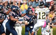 Samford defensive end Brinson Porter (49) and defensive lineman Jerry Mathis (92) pursue Appalachian State quarterback Jamal Jackson (12) at Seibert Stadium in Homewood, Ala., Saturday, Oct 13, 2012. (Marvin Gentry)