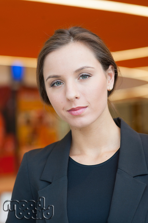 Contemplative businesswoman looking at camera