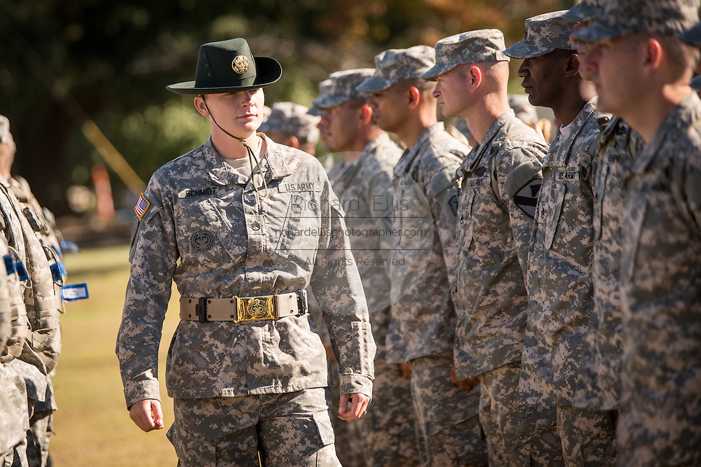 A female Drill Sergeant instructor observes candidates at the US Army Drill Instructors School Fort Jackson during close order drill exercises September 27, 2013 in Columbia, SC. While 14 percent of the Army is women soldiers there is a shortage of female Drill Sergeants.